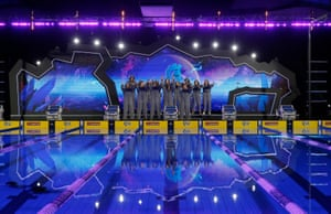 The Aqua Centurion team, wearing identical suits to keep warm, perform a routine as they are introduced to the crowd