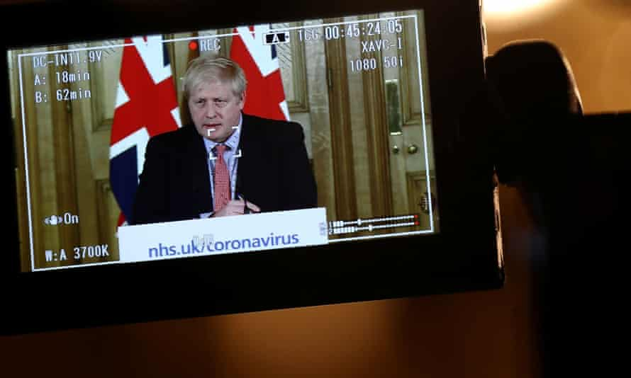 Boris Johnson through a viewfinder during a Downing Street press conference on 12 March 2020.