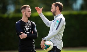 James Maddison (left) speaks to Gareth Southgate during training with England in September.