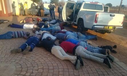 Men lying on the floor at the scene