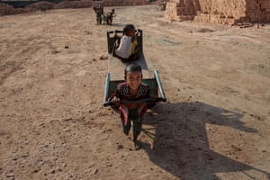 Young children working in a brick yard in Dhaka, Bangladesh