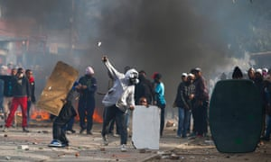 The well organised protesters using masks and burning barricades for protection