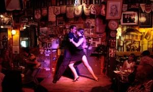 Couple dancing tango at Baar Fun Fun tango bar, Montevideo.