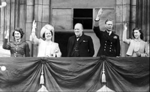 Queen Elizabeth and King George VI joined by Prime Minister Winston Churchill and Princesses Elizabeth and Margaret, on the balcony of Buckingham Palace, London, England, on VE Day on May 8, 1945