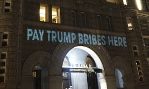 The Trump International Hotel was briefly illuminated with projected messages on 15 May 2017.