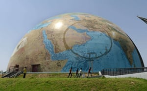 Children play by the Planet Earth Pavilion in the campus of Gujarat Science City in Ahmedabad, India