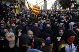 Pro-independence demonstrators shout slogans as they march against Spain's cabinet holding a meeting in Barcelona