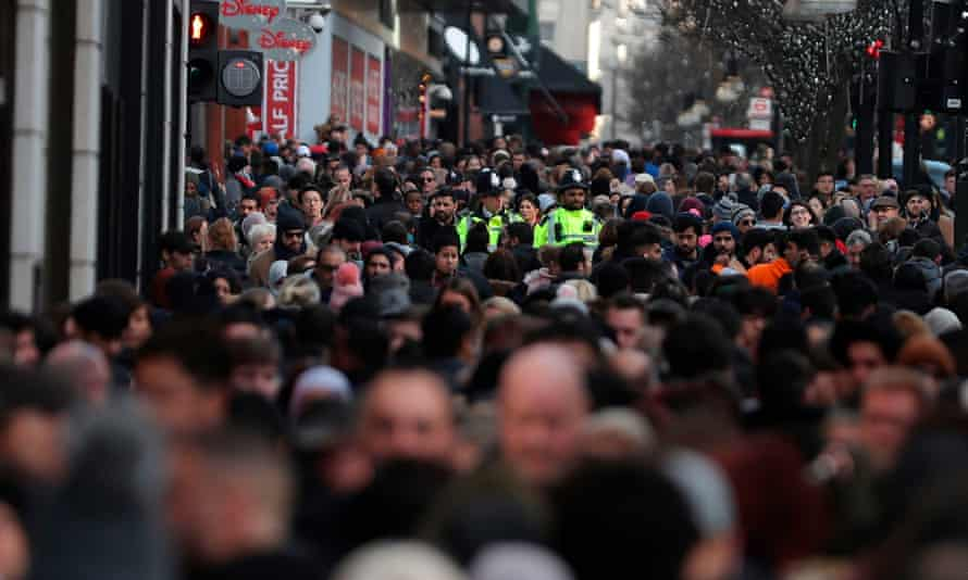 Police mingle with the shoppers on Oxford Street in central London.