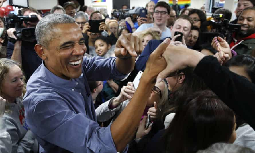 Barack Obama greets Democratic volunteers in a surprise appearance in Fairfax Station, Virginia. Democrats were once shy about defending his healthcare law.