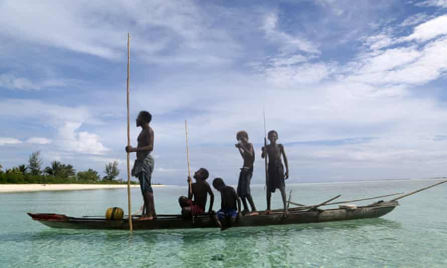Family fishing in PNG. There is concern traditional, subsistence fishing will be displaced by international commercial fleets.