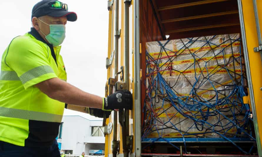 Australia's first shipment of the Pfizer coronavirus vaccine is loaded on to a truck after landing at Sydney airport on Monday