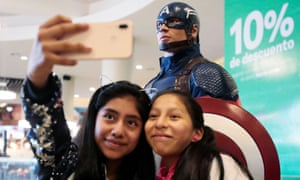 Girls take a selfie with Captain America during an early premiere of Avengers: Endgame in La Paz, Bolivia.
