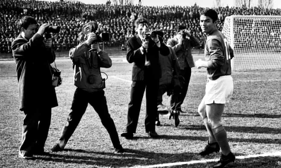 Dragoslav Šekularac being photographed on the pitch in Belgrade.