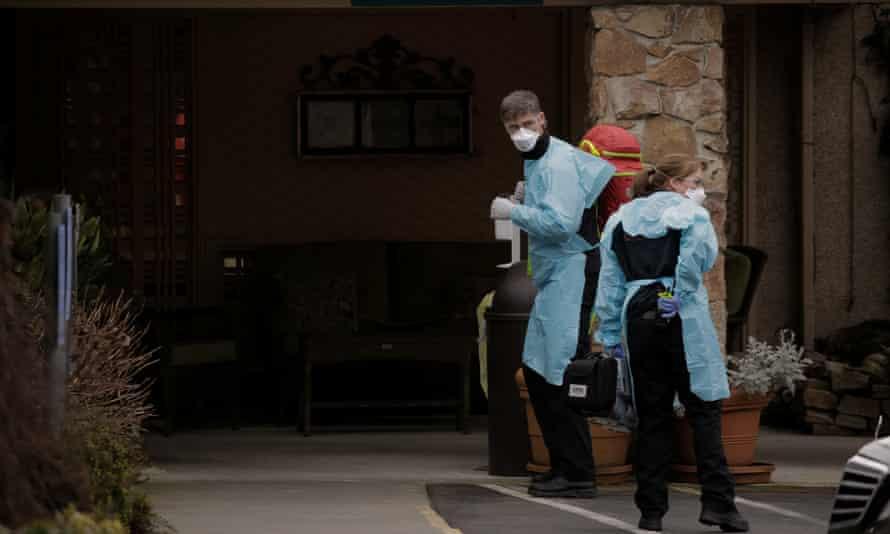 Medics outside the Life Care Center in Kirkland, Washington, on 1 March.
