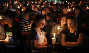 People attend a memorial service for the victims of the shooting at Marjory Stoneman Douglas high school in Parkland, Florida, on 15 February 2018.