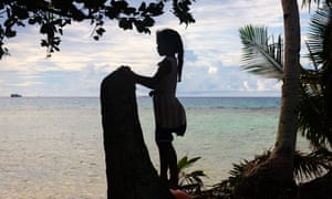 A young girl looks out on to the Funafuti lagoon in Tuvalu, a country that is extremely vulnerable to the climate crisis.