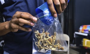 A vendor bags psilocybin mushrooms at a cannabis marketplace in Los Angeles in May 2019. Oakland City Council voted Tuesday to decriminalize the possession and use of entheogenic, or psychoactive, plants and fungi.