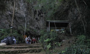 Rescue teams gather at the entrance of the cave  in Chang Rai, northern Thailand