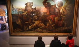 Children look at a painting at the International Slavery Museum in Liverpool