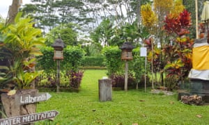 Garden area and signpost to a sacred labyrinth at Bali Silent Retreat, Bali.