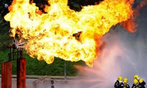 Firefighters extinguish a simulated gas leak