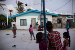 Children play volleyball in Majuro where the minimum wage is $2 and half the population is under 24.