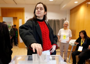 Laura Sancho, 18, voting for the first time, casts a proxy ballot for Catalonia's former president Carles Puigdemont at a polling station in Sant Cugat del Valles