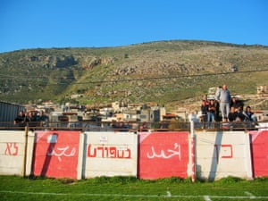 The inscription on this wall in Majd El Krum translates as 'no to violence, yes to sport'