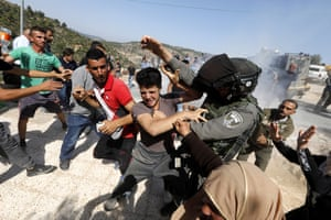 Palestinians scuffle with Israeli border police in Al-Walaja, West Bank