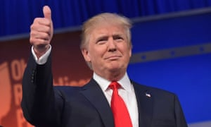 Donald Trump doing a thumbs-up hand signal.