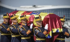 Soldiers carry the flag-draped coffin of Anne of Romania