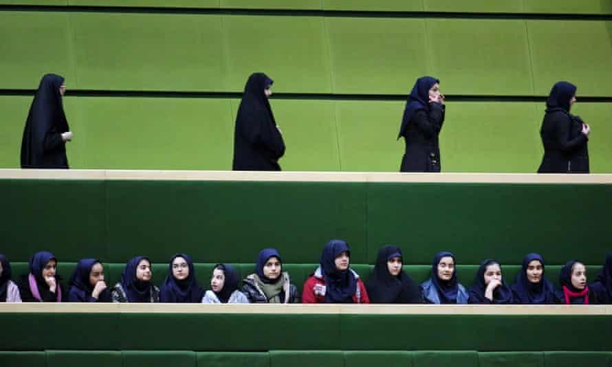 Iranian school-girls attend Rouhani's speech to parliament.