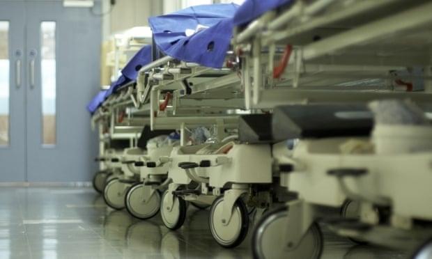 Hospital corridor with bed trolleys