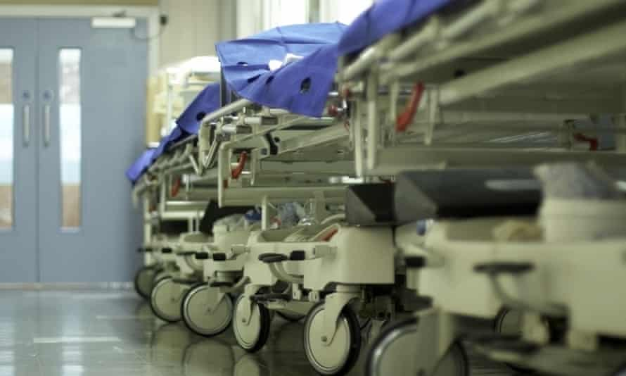 Hospital corridor with gurneys and bed trolleys