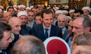 Bashar al-Assad at a mosque with worshippers
