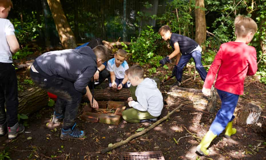 Pupils at a forest school in the grounds of St Mary's primary school, Stockport.
