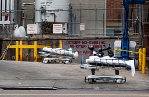 Two bodies on hospital gurneys are staged to be stored in a mobile morgue, put in place due to lack of space at the hospital, outside of the Brooklyn Hospital Center in Brooklyn, New York.