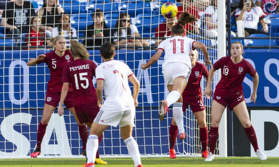 England captain Steph Houghton (left) can only watch as Spain's Alexia Putellas powers a header in from a corner.