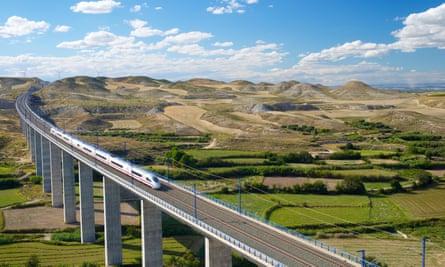 a high-speed train crossing a viaduct in Roden, Zaragoza, Aragon, Spain