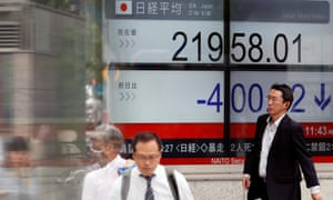 A stock market indicator board in Tokyo on Wednesday.