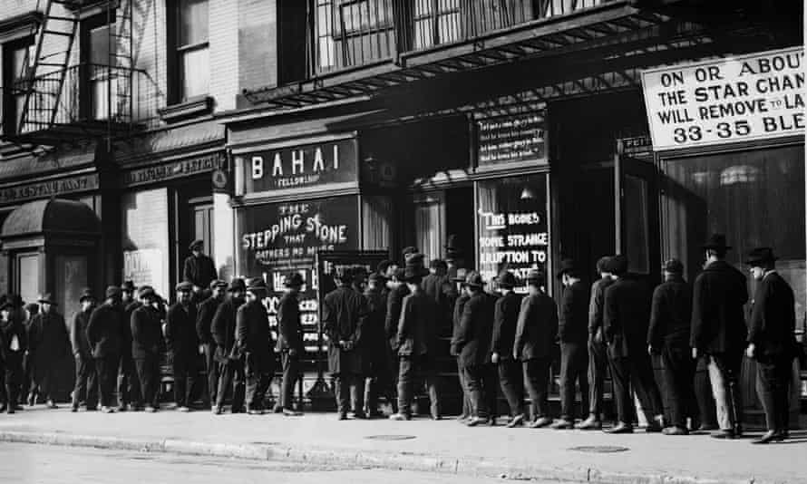 Unemployed men queuing fat a soup kitchen run by the Bahai Fellowship at 203 East 9th Street, New York, circa 1930.