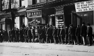 Unemployed men queue for coffee and bread at a soup kitchen in New York, circa 1930