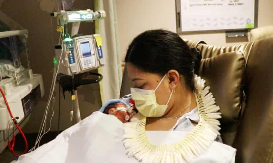 Lavinia Mounga was on her way to a holiday in Hawaii when she gave birth to her son Raymond prematurely on a plane.