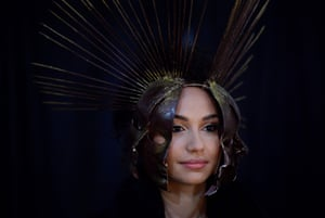 A model wearing a helmet made of chocolate prepares backstage before a fashion show during the annual chocolate festival
