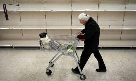 A shopper passes empty shelves in Sainsbury's as the coronavirus outbreak continues.