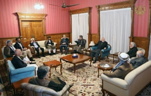 A group of 12 political leaders are seen at the presidential palace in Afghanistan