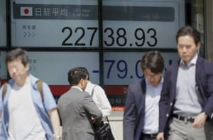 An electronic stock board showing Japan's Nikkei 225 index at a securities firm in Tokyo today.