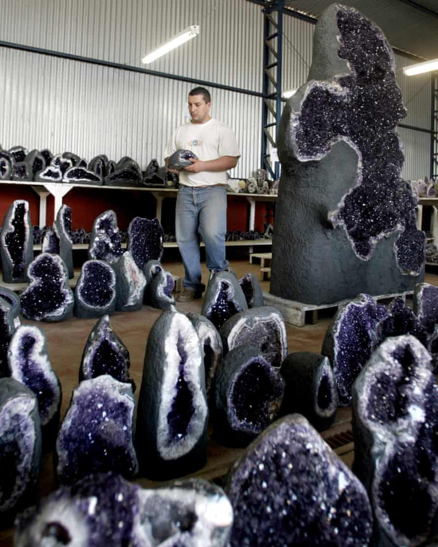 Hard labour: a worker grades amethysts by colour in Uruguay.