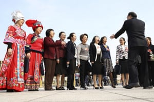 Female delegates prepare for a group photo outside the Great Hall of the People, where a session of the National People's Congress is held in Beijing, China