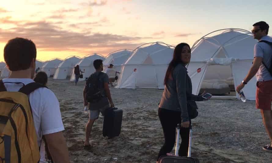 """Fyre Festival attendees arrive to discover that the promised luxury """"bungalows"""" are actually repurposed Fema tents soaked by rain."""